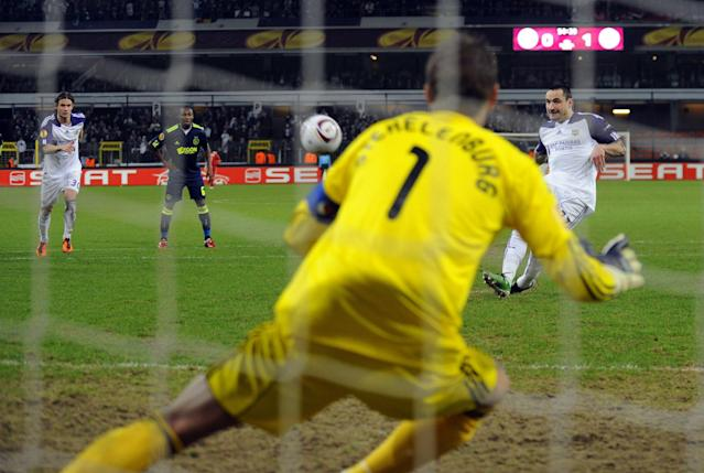 Anderlecht's Marcin Wasilewski (R, back) shoots on a penalty kick but fails to score, as Ajax's goalkeeper Maarten Stekelenburg (front) guards the cage during their Europa League 1/16 finals match between Belgian RSC Anderlecht and Dutch Ajax Amsterdam on February 17, 2011 in Brussels. AFP PHOTO/BELGA /ERIC LALMAND (Photo credit should read ERIC LALMAND/AFP/Getty Images)