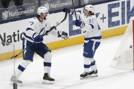 Tampa Bay Lightning's Brayden Point, right, celebrates his goal against the Columbus Blue Jackets with Victor Hedman in overtime of an NHL hockey game Thursday, Jan. 21, 2021, in Columbus, Ohio. (AP Photo/Jay LaPrete)