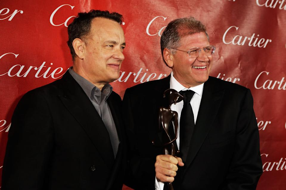 Tom Hanks and Robert Zemeckis with the Director of the Year Award at the Palm Springs International Film Festival on January 5, 2013. (Photo by Jeff Vespa/Getty Images for Palm Springs Film Festival)