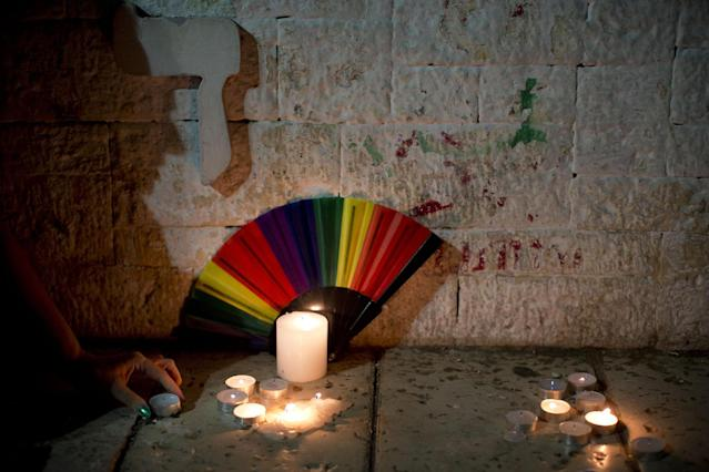 <p>Members LGBT community light candles in solidarity with Florida's shooting attack victims in Tel Aviv, Israel, Sunday, June 12, 2016. The shooting attack in Orlando, Florida, left more than 50 people dead amid a multitude of events celebrating LGBT Pride Month. (AP Photo/Oded Balilty) </p>
