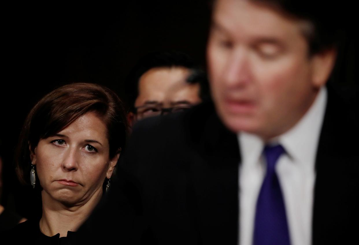 Brett Kavanaugh testifies as Ashley Kavanaugh looks on.