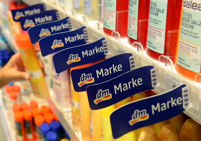 Signs of the dm home brand hang in a store of drugstore chain dm in Karlsruhe, Germany, 23 October 2013. On 24 October 2013, the annual press conference of dm took place in Karlsruhe. Photo: Uli Deck/dpa | usage worldwide (Photo by Uli Deck/picture alliance via Getty Images)