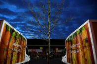FILE PHOTO: Signage for Sainsbury's is seen on delivery vans at a branch of the supermarket in London