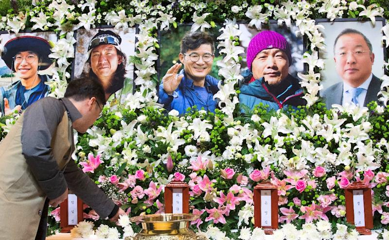 The five South Korean climbers will be laid to rest in a joint funeral on Friday (AFP Photo/-)
