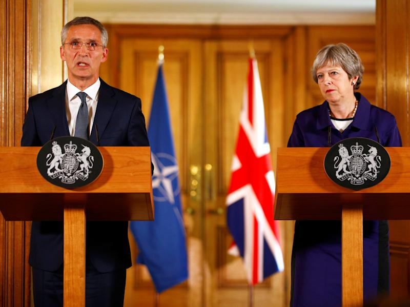 Speaking alongside Jens Stoltenberg, secretary general of Nato, the prime minister insisted Britain would remain a 'leading defence nation': AFP/Getty