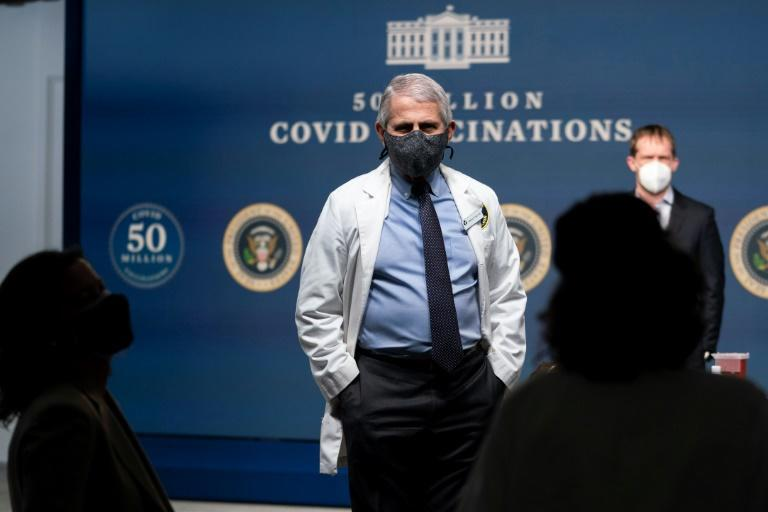 Dr. Anthony Fauci, the top White House advisor on Covid-19, is seen at a Washington event on February 25, 2021; he says authorities are weighing a significant change in social-distancing rules to 3 feet, not 6