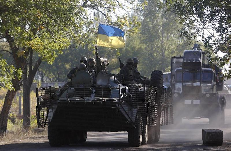 Ukrainian troops patrol in armored vehicles in Donetsk region on September 20, 2014 (AFP Photo/Anatolii Stepanov)