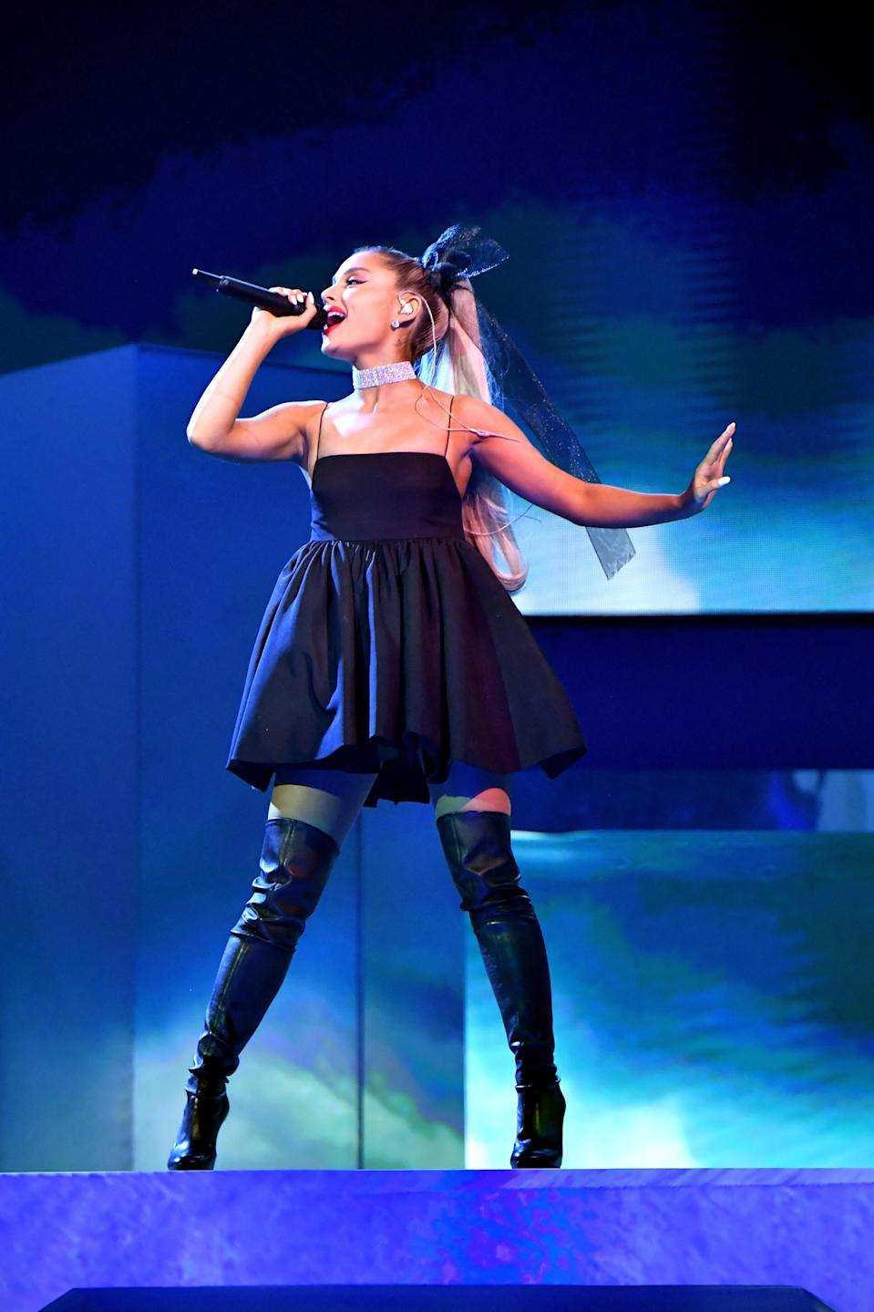 """While performing """"No Tears Left To Cry,"""" the singer looked both chic and sexy in her empire waist LBD with matching thigh-high boots and blinged out choker."""
