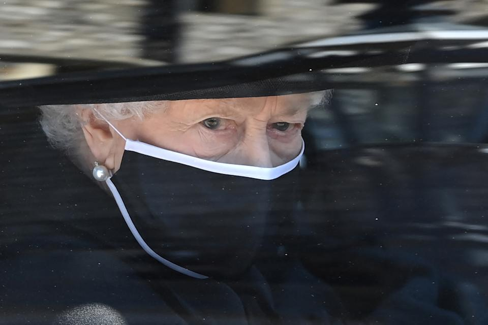 Britain's Queen Elizabeth II arrives in the Royal Bentley at the funeral for her husband, Britain's Prince Philip, Duke of Edinburgh to St George's Chapel in Windsor Castle in Windsor, west of London, on April 17, 2021. - Philip, who was married to Queen Elizabeth II for 73 years, died on April 9 aged 99 just weeks after a month-long stay in hospital for treatment to a heart condition and an infection. (Photo by LEON NEAL / POOL / AFP) (Photo by LEON NEAL/POOL/AFP via Getty Images)