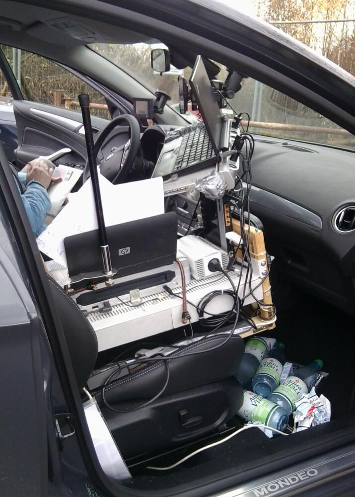 In this photo made available by the Saarland State Police in Germany on Friday Nov. 16, 2012,  shows a vehicle with its  interior wired up like a mobile office, that Saarland State police stopped on the autobahn near Saarbruecken Germany on Monday Nov. 12, 2012. Forget texting while driving. German police say they nabbed a driver who had wired his Ford station wagon with an entire mobile office.  Saarland state police said Friday the 35-year-old man was pulled over for doing 130 km/h (81 mph) in a 100 km/h (62 mph) zone while passing a truck Monday.  Built on a wooden frame on his passenger seat they found a laptop on a docking station tilted for easy driver access, a printer, router, wireless internet stick, WLAN antenna, and an inverter to power it all. A navigation system and cellphone mounted to the windshield completed the array.  Since there wasn't evidence he used the office while moving, he got away with a euro120 ($153) speeding ticket and possible fine for having unsecured items in his car. (AP Photo/Saarland State Police)
