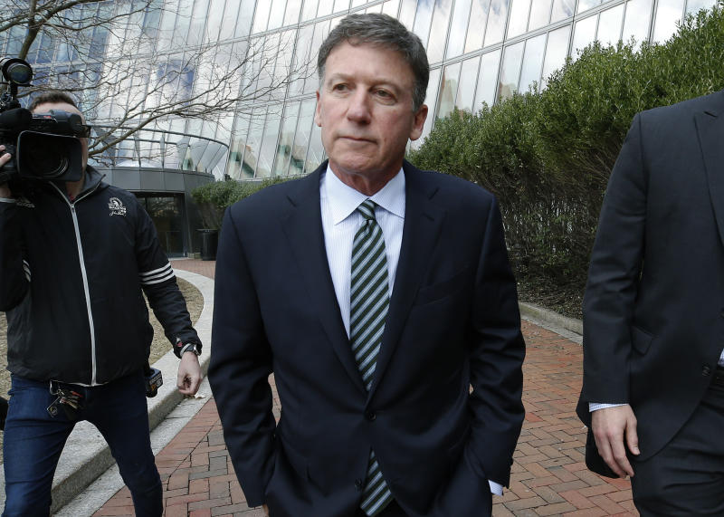 FILE - In this April 3, 2019 file photo, Bruce Isackson departs federal court in Boston after facing charges in a nationwide college admissions bribery scandal. In a court filing on Monday, April 8, 2019, Isackson agreed to plead guilty in the cheating scam. (AP Photos/Michael Dwyer, File)