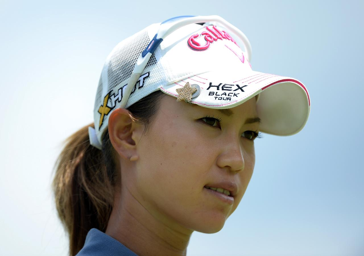 WATERLOO, CANADA - JULY 11: Momoko Ueda of Japan smiles after her birdie as she leaves the 10th green during round one of the Manulife Financial LPGA Classic at the Grey Silo Golf Course on July 11, 2013 in Waterloo, Canada. (Photo by Harry How/Getty Images)