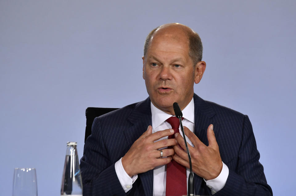 """German Finance Minister and Vice-Chancellor Olaf Scholz addresses a press conference at the Chancellery in Berlin, Wednesday June 3, 2020, after coalition meetings. Germany's governing parties agreed on a 130 billion euro ($146 billion) stimulus package Wednesday meant to help kick-start Europe's biggest economy, which has taken a heavy hit from the coronavirus pandemic. Following two days of talks in Berlin, Chancellor Angela Merkel said the package was a """"bold response"""" that would boost consumption and investment and ease the strain on families and others. (John MacDougall/Pool via AP)"""