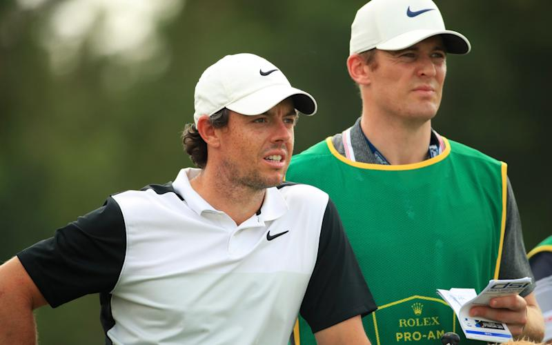 Rory McIlroy (left) is using his friend Niall O'Connor as a temporary caddy this week - Getty Images Europe