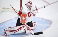 Switzerland's goalie Andrea Braendli deflects a shot during first period of an IIHF women's world hockey championships game between Russian Olympic Committee and Switzerland, in Calgary, Alberta, Saturday, Aug. 28, 2021, in Calgary, Alta., Saturday, Aug. 28, 2021. (Jeff McIntosh/The Canadian Press via AP)