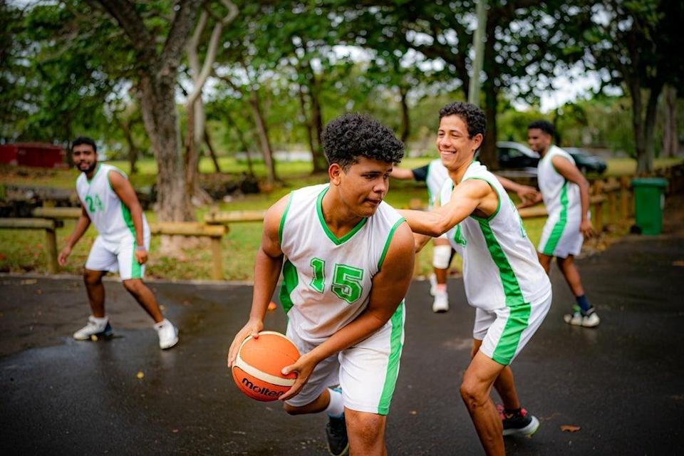 Young basketball players at a training hub in Mauritius, where youngsters are given free training and coaching to help them pursue a career in professional sport (Ben Birchall/PA) (PA Wire)