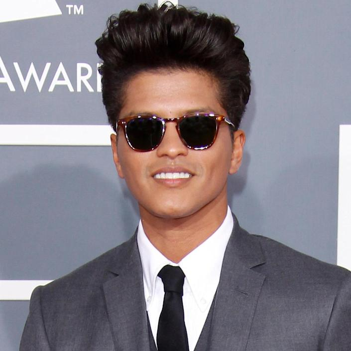 """<p>Mars arrived at the 54th Annual Grammy Awards sporting sunnies and that uber-cool pompadour. He was nominated for a whopping six awards that year, including Album of the Year for his debut album <em>Doo-Wops & Hooligans</em>, and Song of the Year for his catchy single, """"Grenade."""" </p>"""