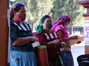 Mexicans wait to cast their votes in San Bartolome Quialana in the southern state of Oaxaca