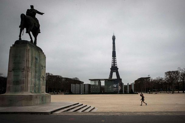 PHOTO: In this file photo taken on March 21, 2020, a jogger runs at the Champs de Mars in Paris as a strict nationwide lockdown comes into in effect in France to stop the spread of the novel coronavirus. (Joel Saget/AFP via Getty Images)