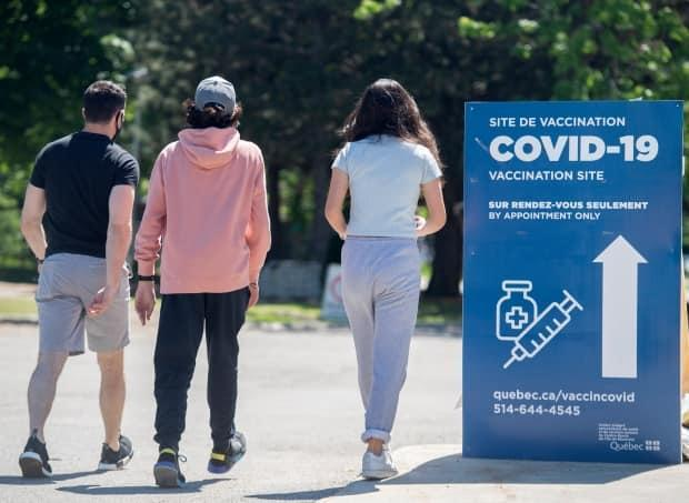 For a return to in-class school this fall in CEGEPs and universities, Health Minister Christian Dubé says a minimum 75% vaccination rate among the 18-29 age group is needed. (Graham Hughes/CP - image credit)