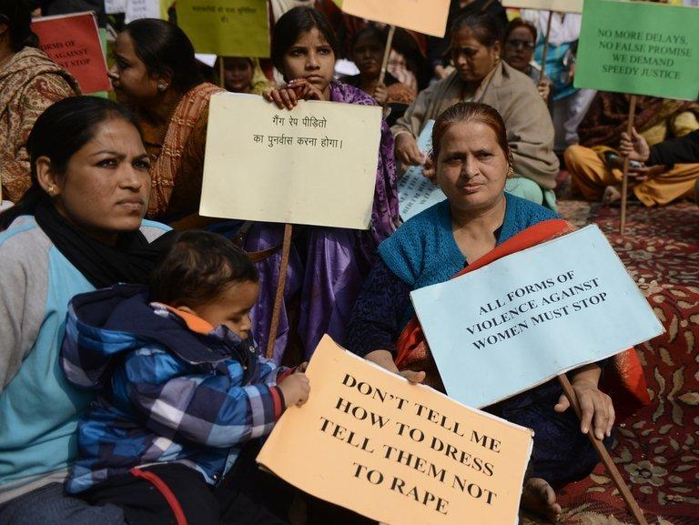 Indian activists hold placards during a protest against the gang rape and murder of a student in New Delhi on January 15, 2013