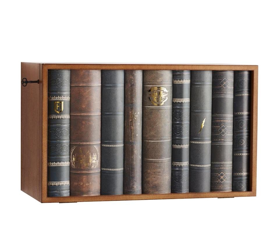 <p>This Faux Book Lockbox ($139) opens up to reveal tons of space for storing your kids' knickknacks and toys.</p>