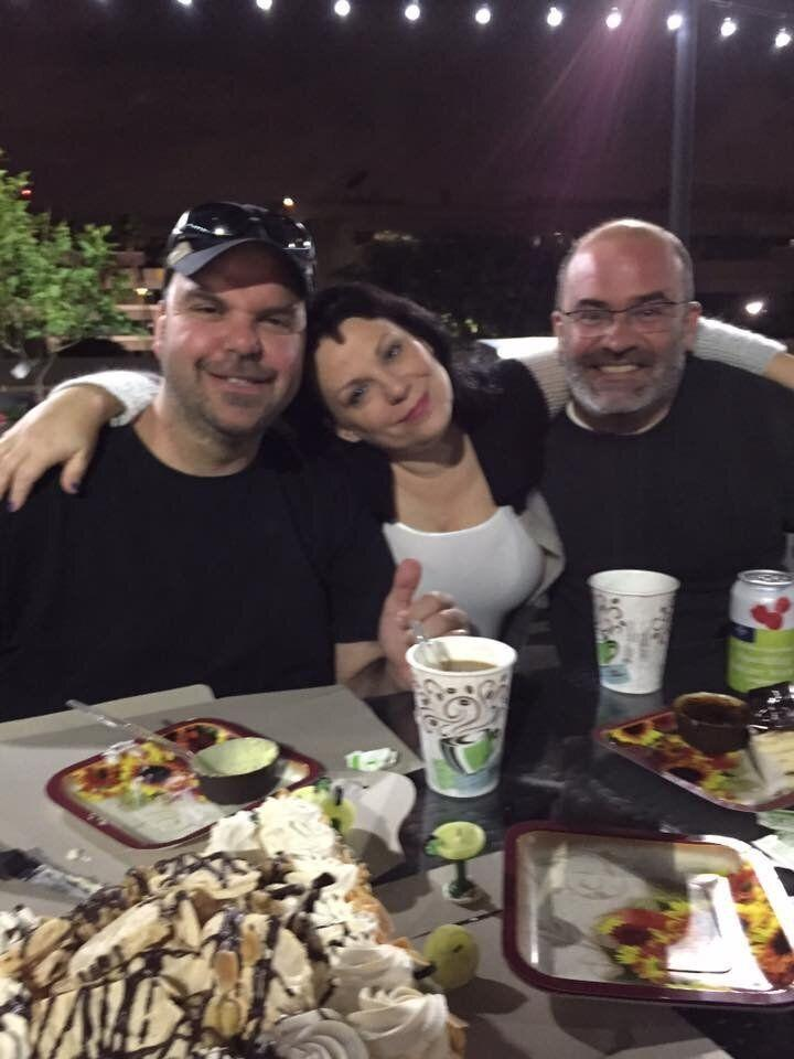 Walton, Smyth and Walton's husband, Pablito, hanging out in the BBQ area of their apartment complex (2015). (Photo: Courtesy of Johnathan Walton)