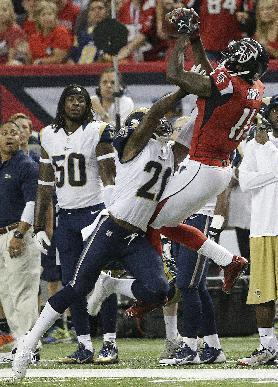 Atlanta Falcons wide receiver Julio Jones (11) works against St. Louis Rams cornerback Janoris Jenkins (21) during the first half of an NFL football game, Sunday, Sept. 15, 2013, in Atlanta. (AP Photo/John Bazemore)