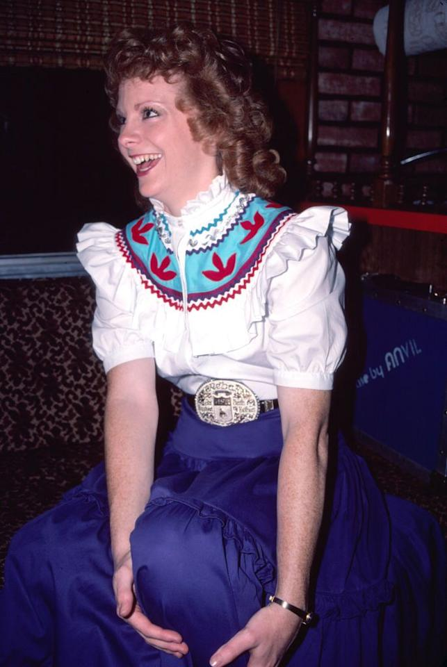 <p>Reba was well-ahead of 2020's puffy-sleeve trend, rocking the high-fashion look all the way back in 1982.</p>