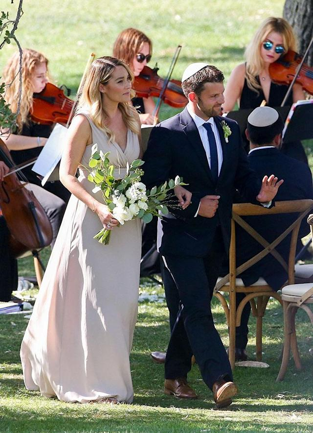 "<p>Conrad served as a bridesmaid at a wedding in Ojai, Calif., just six weeks after <a href=""https://www.yahoo.com/celebrity/lauren-conrad-reportedly-welcomes-first-005000712.html"" data-ylk=""slk:welcoming a son"" class=""link rapid-noclick-resp"">welcoming a son</a>, Liam, with her husband, William Tell. Pretty bridesmaid dress, right? Too bad she'll never wear it again, no matter what the bride says. (Photo: Backgrid) </p>"