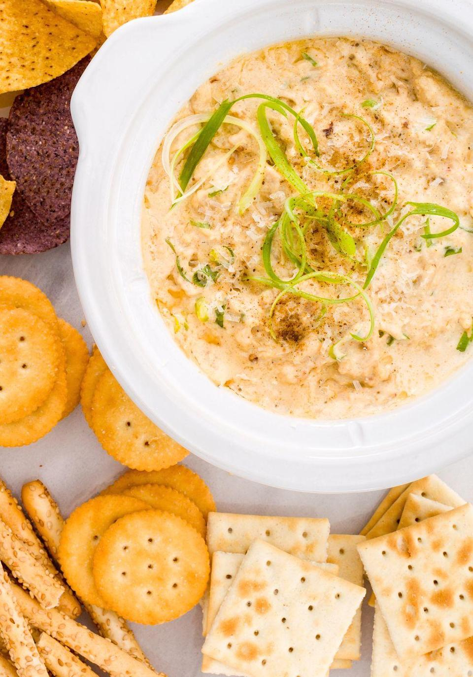 """<p>Just swap out the Ritz Crackers for serving with this <a href=""""https://www.delish.com/cooking/recipe-ideas/a25633559/keto-crackers-recipe/"""" rel=""""nofollow noopener"""" target=""""_blank"""" data-ylk=""""slk:Keto rendition"""" class=""""link rapid-noclick-resp"""">Keto rendition</a> and you're good to go.</p><p>Get the recipe from <a href=""""https://www.delish.com/cooking/recipe-ideas/recipes/a44678/slow-cooker-crab-dip-recipe/"""" rel=""""nofollow noopener"""" target=""""_blank"""" data-ylk=""""slk:Delish"""" class=""""link rapid-noclick-resp"""">Delish</a>. </p>"""