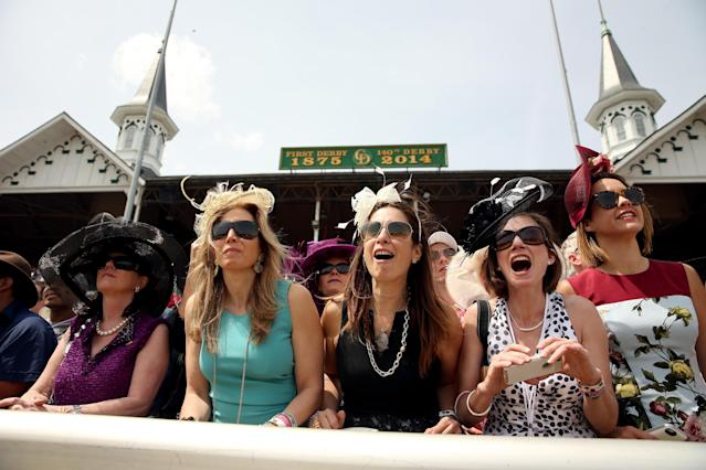 LOUISVILLE, KY - MAY 03: Race fans cheer wearing a festive hat prior to the 140th running of the Kentucky Derby at Churchill Downs on May 3, 2014 in Louisville, Kentucky. (Photo by Matthew Stockman/Getty Images)