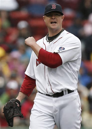 Boston Red Sox starting pitcher Jon Lester reacts leaving the mound after giving up two runs during the third inning of a baseball game against the Cleveland Indians at Fenway Park in Boston Saturday, May 25, 2013. (AP Photo/Winslow Townson)