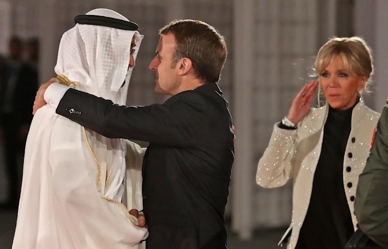 Abu Dhabi Crown Prince Mohammed bin Zayed Al-Nahyan greets French President Emmanuel Macron (C) and his wife Brigitte Macron at the entrance of the Louvre Abu Dhabi Museum on November 8, 2017 during its inauguration (AFP Photo/KARIM SAHIB)