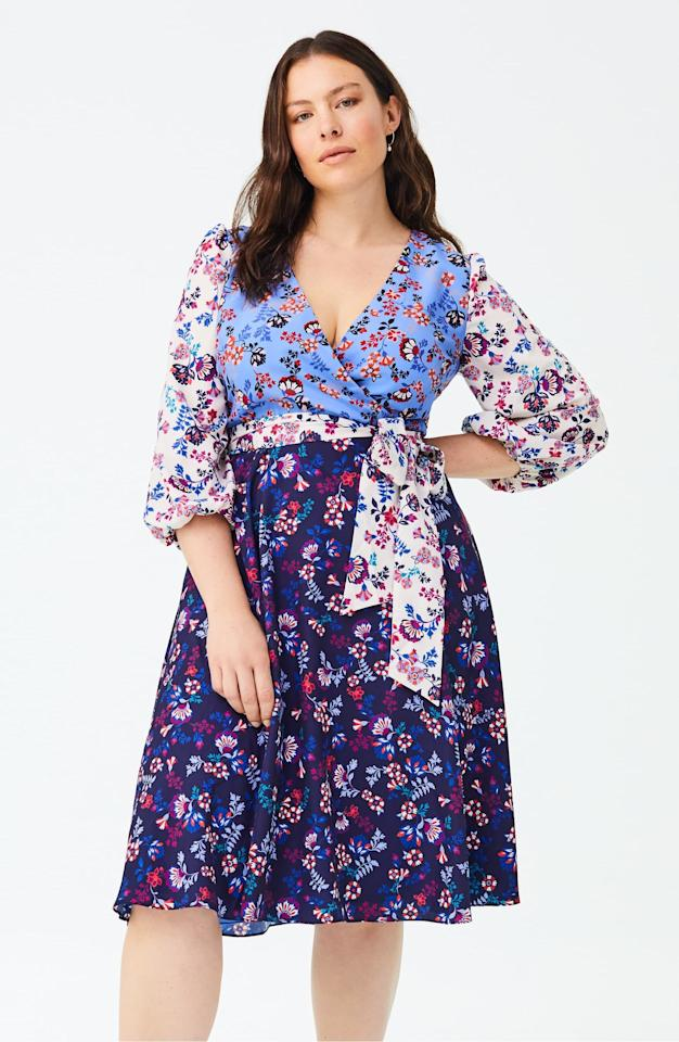 """<p>We love the mix of prints on this <a href=""""https://www.popsugar.com/buy/1901-Colorblock-Floral-Faux-Wrap-Dress-484448?p_name=1901%20Colorblock%20Floral%20Faux%20Wrap%20Dress&retailer=shop.nordstrom.com&pid=484448&price=149&evar1=fab%3Auk&evar9=45208505&evar98=https%3A%2F%2Fwww.popsugar.com%2Ffashion%2Fphoto-gallery%2F45208505%2Fimage%2F46581895%2F1901-Colorblock-Floral-Faux-Wrap-Dress&list1=shopping%2Cfall%20fashion%2Cdresses%2Cfall%2Ccurvy%20fashion&prop13=api&pdata=1"""" rel=""""nofollow"""" data-shoppable-link=""""1"""" target=""""_blank"""" class=""""ga-track"""" data-ga-category=""""Related"""" data-ga-label=""""https://shop.nordstrom.com/s/1901-colorblock-floral-faux-wrap-dress-plus-size/5282077?origin=category-personalizedsort&amp;breadcrumb=Home%2FWomen%2FClothing%2FPlus-Size%20Clothing%2FDresses&amp;color=blue%20floral"""" data-ga-action=""""In-Line Links"""">1901 Colorblock Floral Faux Wrap Dress</a> ($149).</p>"""