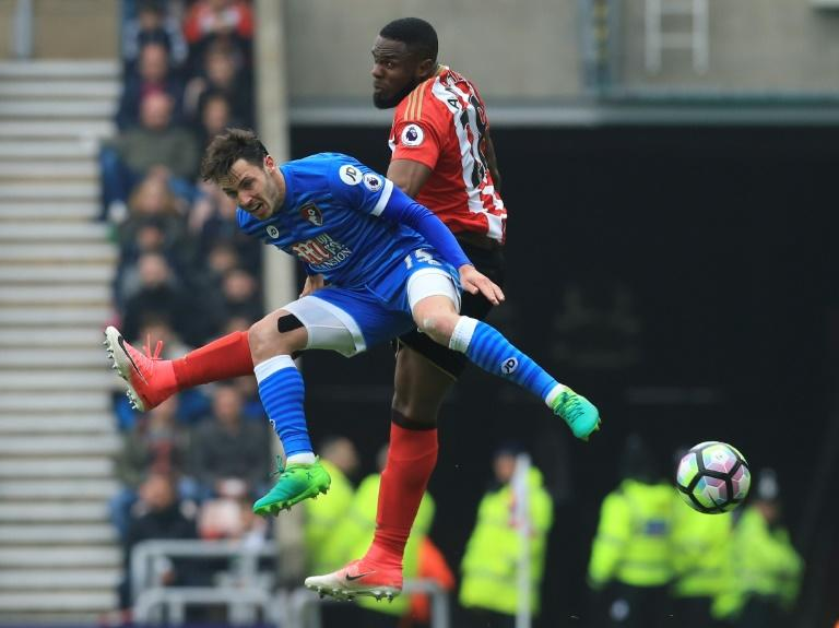 Sunderland's Victor Anichebe (R) challenges Bournemouth's English defender Adam Smith (L) during their Premier league match at the Stadium of Light in Sunderland, north-east England on April 29, 2017