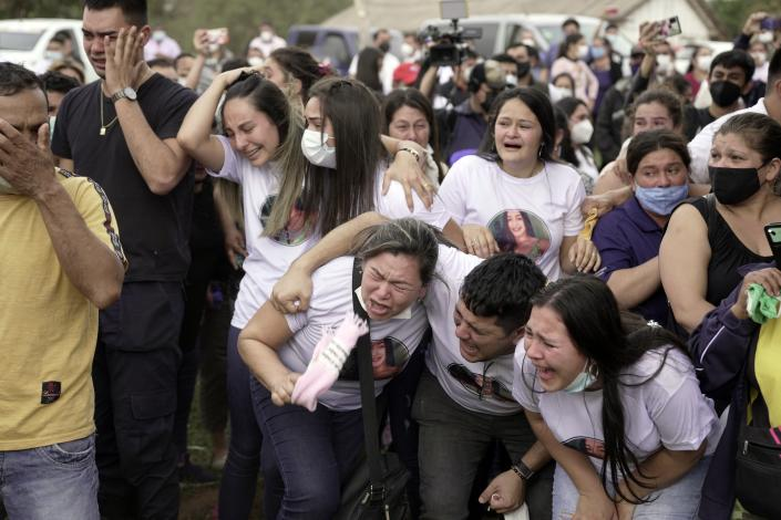 Friends and relatives of Leidy Vanessa Luna Villalba react as the coffin that contain her remains arrives outside her home, in Eugenio Garay, Paraguay, Tuesday, July 13, 2021. Luna Villalba, a nanny employed by the sister of Paraguay's first lady Silvana Lopez Moreira, was among those who died in the Champlain Towers South condominium collapse in Surfside, Florida on June 24. (AP Photo/Jorge Saenz)