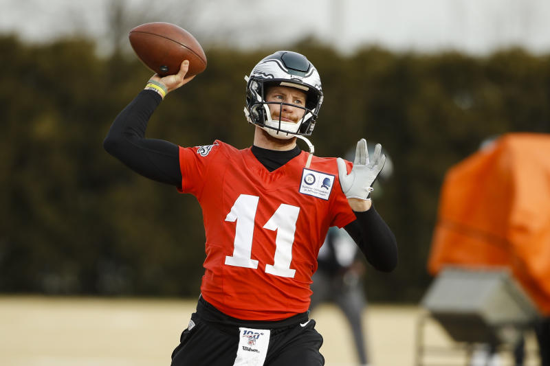 Philadelphia Eagles quarterback Carson Wentz throws a pass at the NFL football team's practice facility in Philadelphia, Thursday, Jan. 2, 2020. The Seattle Seahawks travel to Philadelphia to play the Eagles in an NFC wild-card matchup on Sunday. (AP Photo/Matt Rourke)
