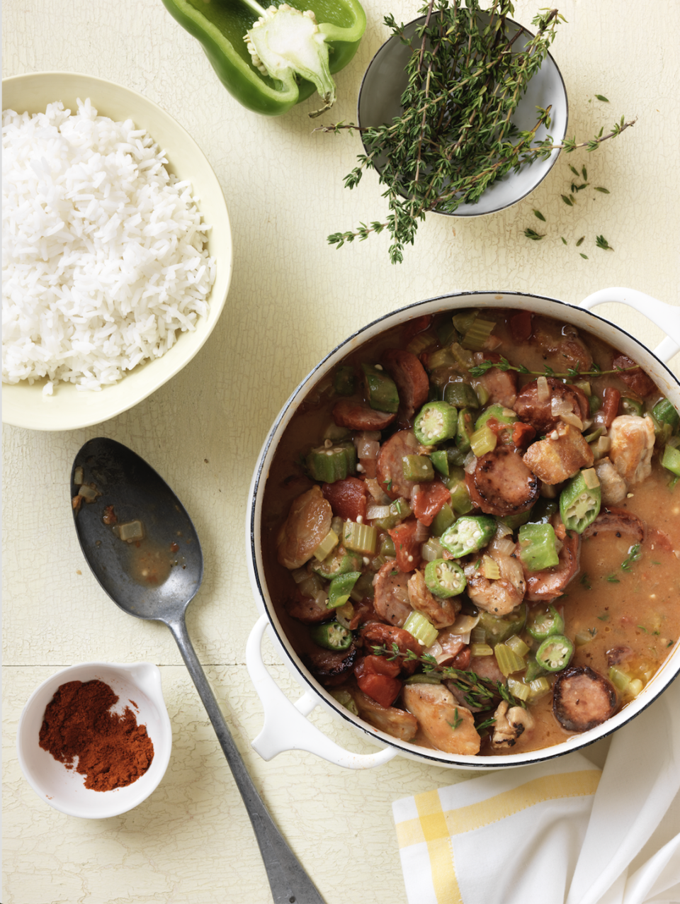 """<p>The official dish of Louisiana, Gumbo generally consists of meat or shellfish, a thickener like flour and veggies. Our hearty version uses chicken and sausage.</p><p><em><a href=""""https://www.womansday.com/food-recipes/food-drinks/recipes/a11687/gumbo-recipe-wdy1012/"""" rel=""""nofollow noopener"""" target=""""_blank"""" data-ylk=""""slk:Get the recipe from Woman's Day »"""" class=""""link rapid-noclick-resp"""">Get the recipe from Woman's Day »</a></em></p>"""