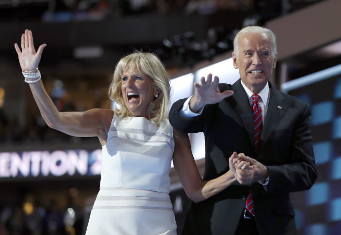 """FILE - In this July 27, 2016 file photo, Dr. Jill Biden and Vice President Joe Biden wave after speaking to delegates during the third day session of the Democratic National Convention in Philadelphia. Flatiron Books said Wednesday, April 5, 2017, that it will release two books by Joe Biden and one by Jill. Joe Biden's first book will """"explore one momentous year,"""" 2016, when his son Beau died and he decided against running for president. The book is currently untitled and no release date was announced. (AP Photo/Carolyn Kaster, File)"""