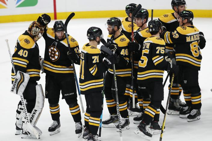 Boston Bruins Tuukka Rask (40) and teammates celebrate after defeating the Washington Capitals during an NHL hockey game, Sunday, April 18, 2021, in Boston. (AP Photo/Michael Dwyer)