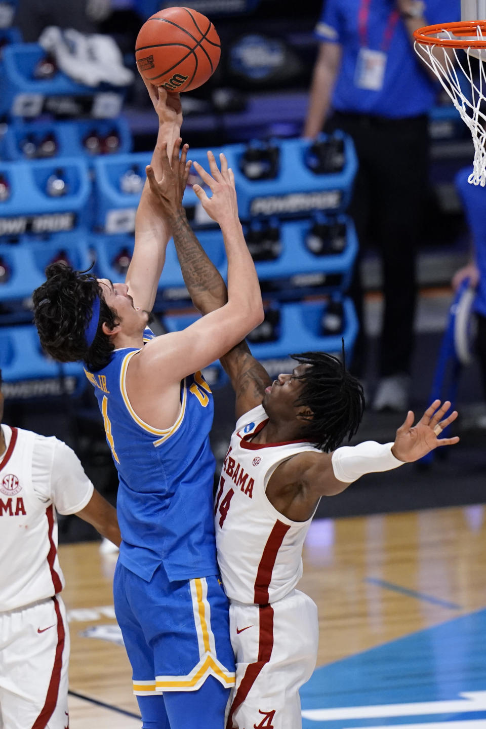 UCLA guard Jaime Jaquez Jr. (4) shoots on Alabama guard Keon Ellis (14) in the second half of a Sweet 16 game in the NCAA men's college basketball tournament at Hinkle Fieldhouse in Indianapolis, Sunday, March 28, 2021. (AP Photo/AJ Mast)