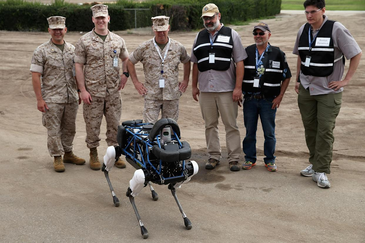 Boston's dog: United States Marines and representatives from Boston Dynamics look at Spot, a four-legged robot designed for indoor and outdoor operation. Photo: Chip Somodevilla/Getty Images