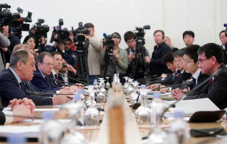 Russian Foreign Minister Sergei Lavrov (L) and his Japanese counterpart Taro Kono (R) attend a meeting in Moscow, Russia January 14, 2019. REUTERS/Maxim Shemetov