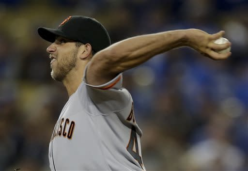 San Francisco Giants starting pitcher Madison Bumgarner throws against the Los Angeles Dodgers during the eighth inning of a baseball game in Los Angeles, Tuesday, April 2, 2013. (AP Photo/Jae C. Hong)