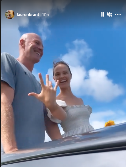 Lauren Brant and Barry Hall on their wedding day showing off rings