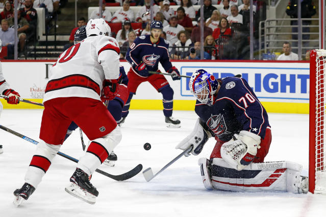 Carolina Hurricanes' Sebastian Aho (20), of Finland, has his shot blocked by Columbus Blue Jackets goaltender Joonas Korpisalo (70), also of Finland, during the second period of an NHL hockey game in Raleigh, N.C., Saturday, Oct. 12, 2019. (AP Photo/Karl B DeBlaker)