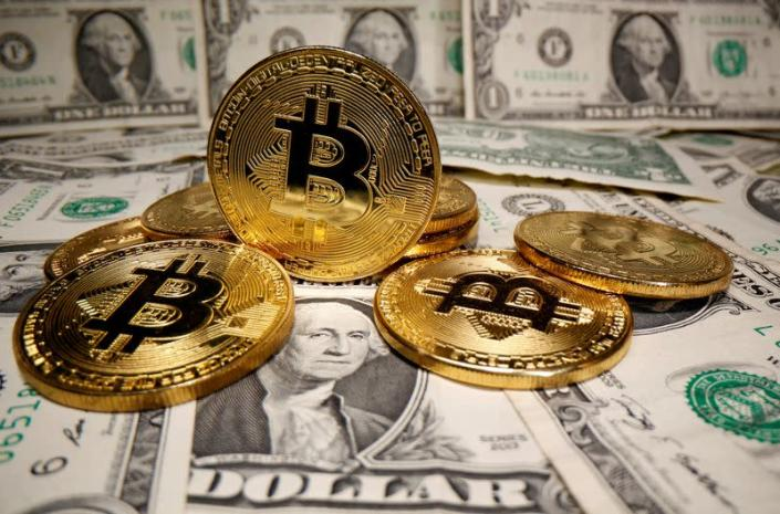 FILE PHOTO: Representations of virtual currency Bitcoin are placed on U.S. Dollar banknotes