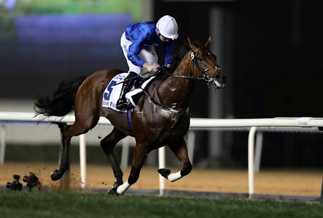 Horse Racing - Dubai World Cup 2018 - Meydan Racecourse, Dubai - United Arab Emirates - March 31, 2018 - Oisin Murphy rides Benbatl from Britain to the finish line to win the Seventh Race. REUTERS/Ahmed Jadallah