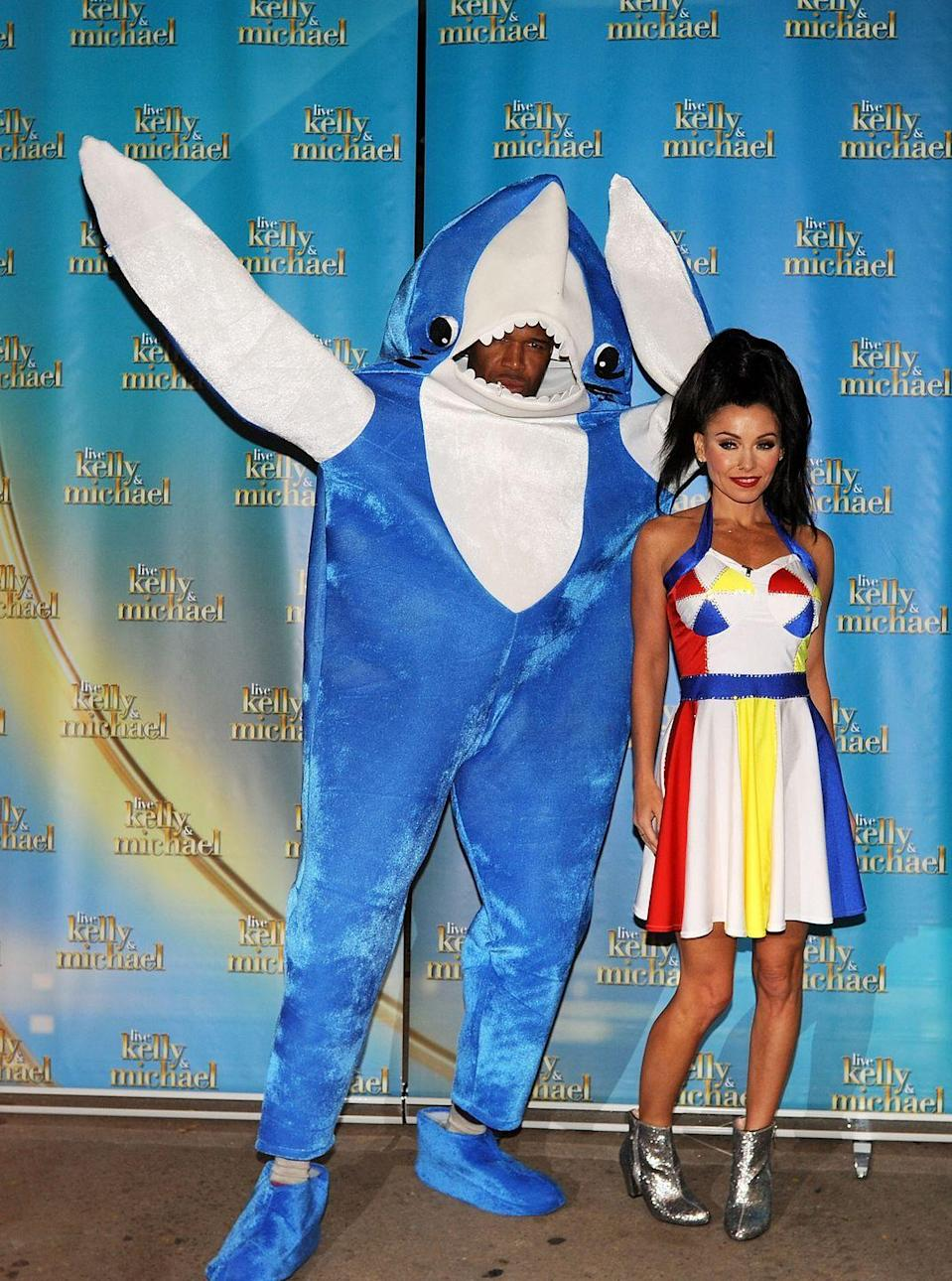 """<p>Michael Strahan as Left Shark and Kelly Ripa as Katy Perry on """"Live With Kelly & Michael"""" LIVE's Best Halloween Show Ever on October 30, 2015 in New York City.</p>"""